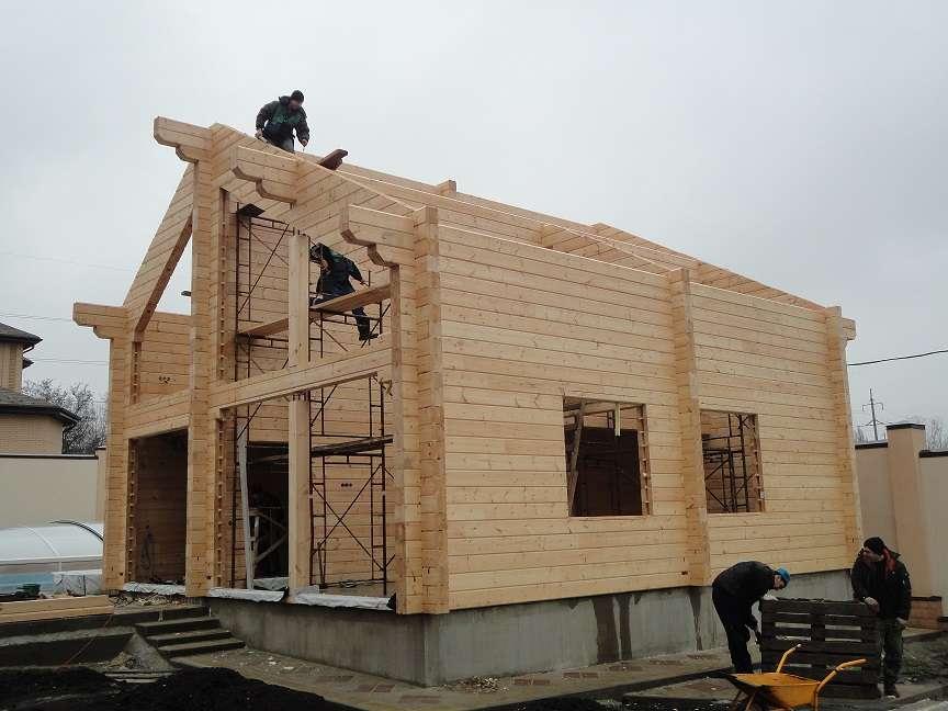 Log houses and cylinders and hewn log